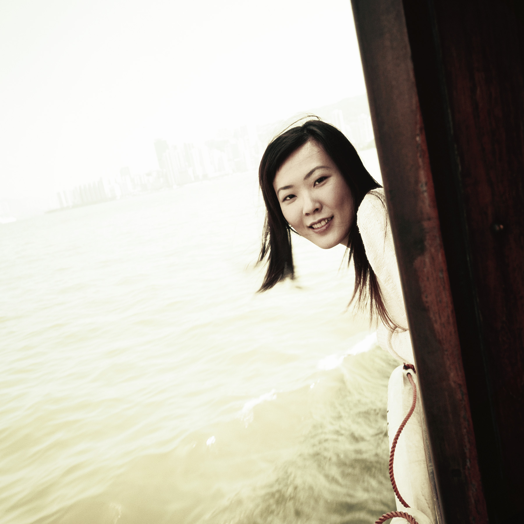 Portrait of young woman on Hong Kong Ferry