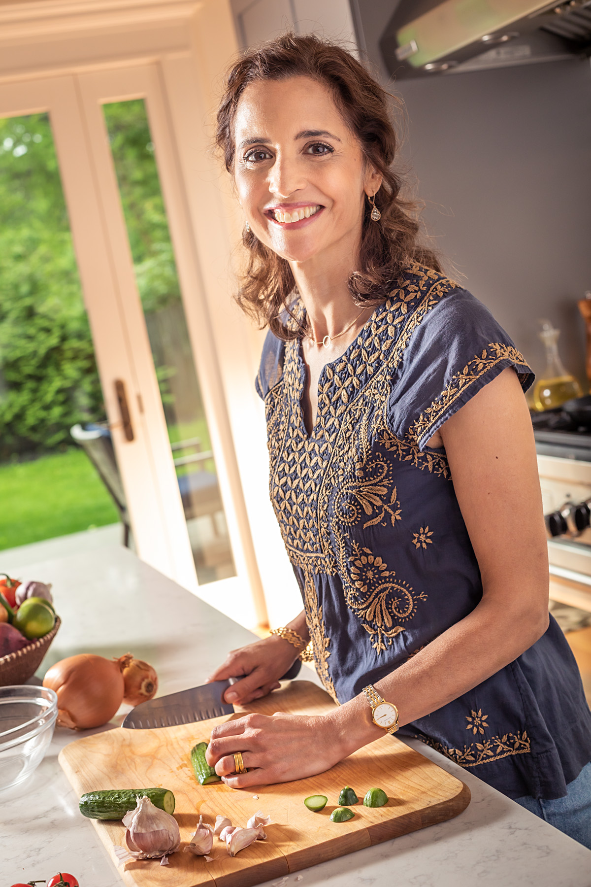 Maya Kaimal cooking in Kitchen